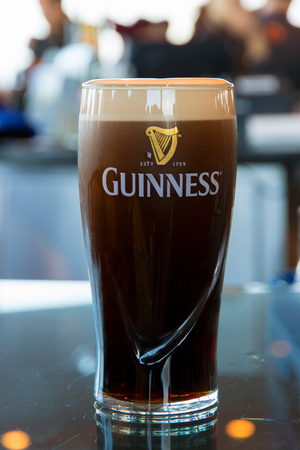 DUBLIN, IRELAND - FEB 15, 2014:  Pint of Guinness, the popular Irish beer Редакционное
