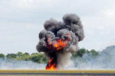 Large explosion with black smoke Stock Photo
