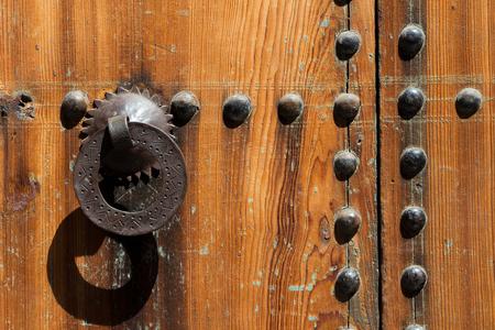 Old iron door knocker on a wooden door in Marrakesh, Morocco Stock Photo