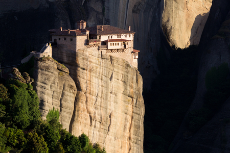 kalampaka: Beautiful scenic view of the Orthodox Monastery of Rousanou (St. Barbara) on a monolithic pillar, with a dark shadow background in Meteora, Pindos Mountains, Greece Stock Photo