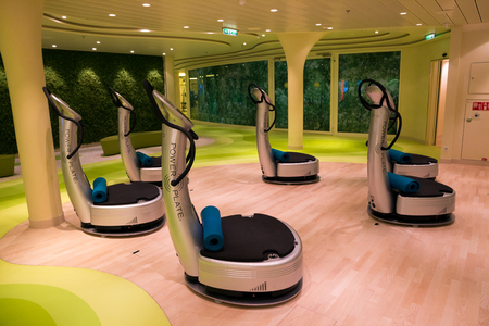 ROTTERDAM - NOV 24, 2016: Power Plates in the fitness center on board of the AIDAprima cruise ship.