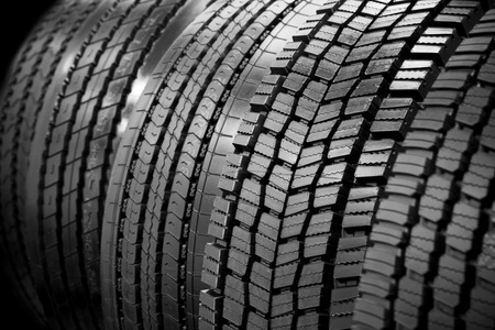 winter tires: Different profile truck tires on a black background