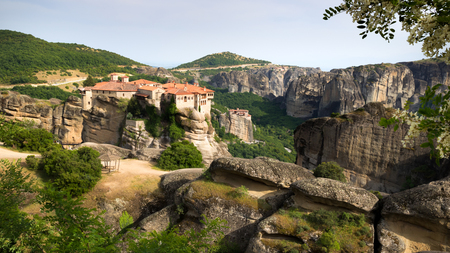 Scenic view of the Varlaam and Rousanou Monastery on a monolithic pillar in Meteora, Greece
