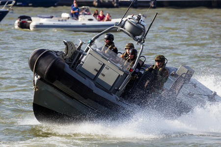 anti piracy: ROTTERDAM, NETHERLANDS - SEP 3, 2016: Fast speedboat with Dutch Marines during an assault demo at the World Harbor Days in Rotterdam.
