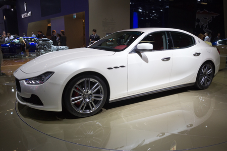 FRANKFURT, GERMANY - SEP 13: Maserati Ghibli at the IAA motor show on Sep 13, 2013 in Frankfurt. More than 1.000 exhibitors from 35 countries are present at the worlds largest motor show.