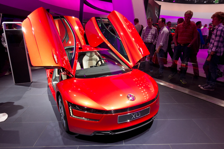 sep: FRANKFURT, GERMANY - SEP 20: Volkswagen XL1 at the IAA motor show on Sep 20, 2013 in Frankfurt. More than 1.000 exhibitors from 35 countries are present at the worlds largest motor show.