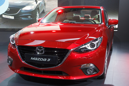 FRANKFURT, GERMANY - SEP 13: New Mazda3 at the IAA motor show on Sep 13, 2013 in Frankfurt. More than 1.000 exhibitors from 35 countries are present at the worlds largest motor show.