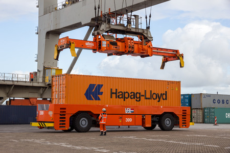 sep: ROTTERDAM - SEP 6, 2015: Crane operator picking up a sea container in the Port of Rotterdam. Editorial