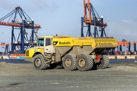 ROTTERDAM, NETHERLANDS - JAN 13, 2012: Boskalis dump truck on the construction site of a new harbor in sea, called Maasvlakte 2, in the Port of Rotterdam.