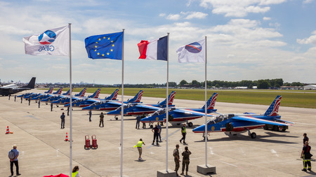 PARIS, FRANCE - JUN 23, 2017: France and EU flags in front of the Patrouille de France aerobatic team at the Paris Air Show 2017