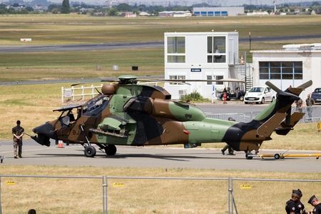 PARIS, FRANCE - JUN 23, 2017: French Army Eurocopter-Airbus EC665 Tigre attack helicopter being towed to the static after flying at the Paris Air Show 2017 Editorial