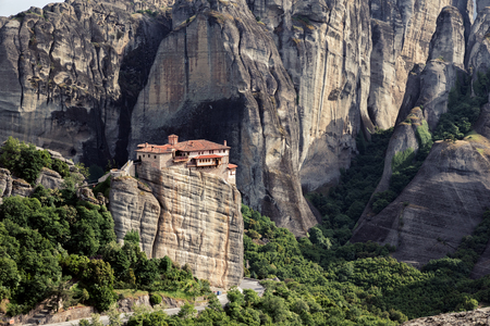 kalabaka: Scenic view on the Orthodox monastery of Rousanou (St. Barbara) on a monolithic pillar and its surrounding rocky landscape in Meteora, Greece