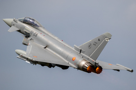 FLORENNES, BELGIUM - JUN 15, 2017: Spanish Air Force Eurofighter Typhoon fighter jet taking off with afterburner from Florennes Airbase. Editorial