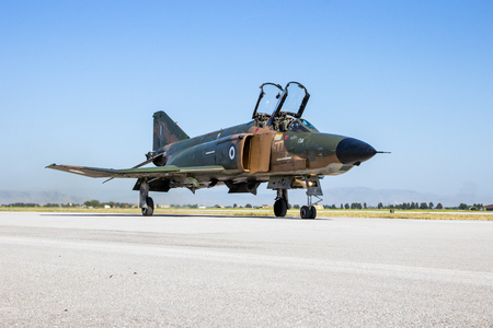 LARISSA, GREECE - MAY 4, 2017: Hellenic Air Force RF-4E Phantom II fighter jet plane taxiing after one of its last flights. 348 Reconnaissance Squadron suspends operations after 64 years. Editorial