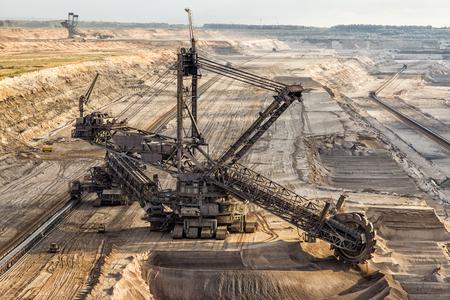 sand quarry: Bucket-wheel excavator mining in a brown coal open pit mine.
