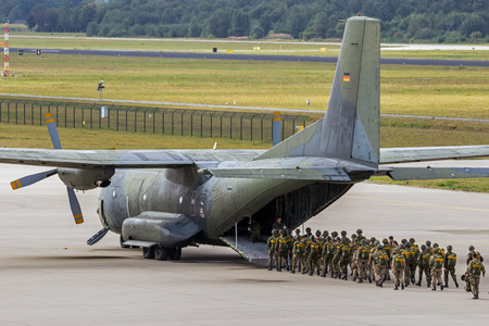 EINDHOVEN, THE NETHERLANDS - SEP 17, 2016: British and Dutch Paratroopers entering a German Air Force C-160 Transall plane for a jump at the Market Garden Memorial.