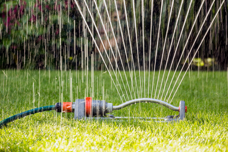 Close up of a lawn sprinkler Stock Photo