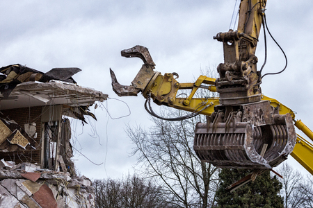 Demolition cranes dismantling a building