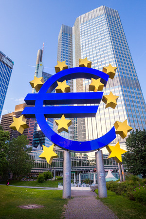 FRANKFURT, GERMANY - JUL 11, 2013: Euro sign outside the European Central Bank. The ECB is building new premises in Frankfurt, due for completion in 2013. Editorial
