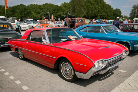 restored: DEN BOSCH, THE NETHERLANDS - MAY 10, 2015: Red 1962 Ford Thunderbird Hardtop classic car.
