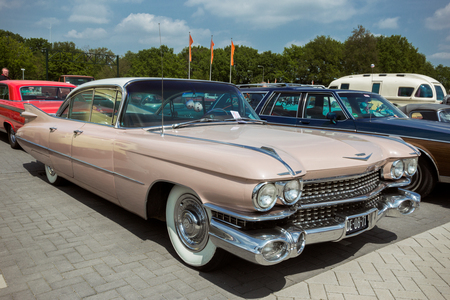 DEN BOSCH, THE NETHERLANDS - MAY 10, 2015: Pink 1959 Cadillac Sedan De Ville classic car. Editorial