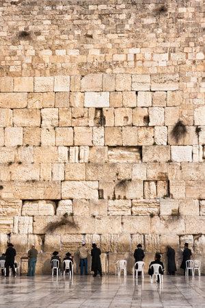 JERUSALEM, ISRAEL - JAN 26, 2011: Jewish worshipers pray at the Western Wall in Jerusalem, Israel.