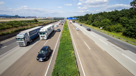 FRANKFURT, GERMANY - JULY 11, 2013: Traffic on a German highway. German autobahns have no general speedlimit and rank as the fifth longest highway system.