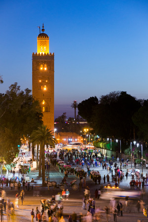 Sunset view on the Djemaa el Fna square and the Koutoubia mosque, Marrakesh, Morocco Editorial