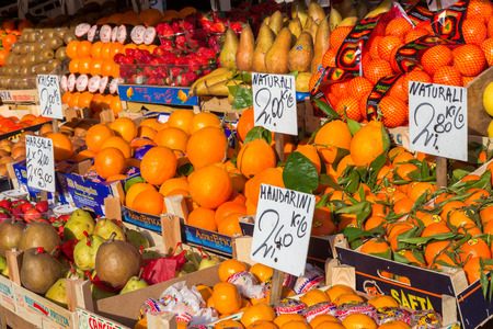 VENICE, ITALY - FEB 8, 2013: Various fruits from local farmers at a fruit stall in Venice.