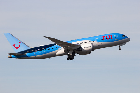 AMSTERDAM-SCHIPHOL - FEB 16, 2016: TUI Airlines Boeing 787 Dreamliner airplane take-off from Schiphol airport