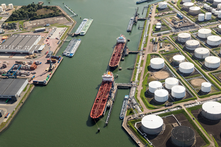 Aerial view of oil tankers moored at a oil storage terminal.