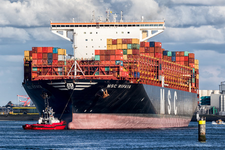 ROTTERDAM, THE NETHERLANDS - SEP 2, 2017: Container ship from MSC being tugged into the Port of Rotterdam