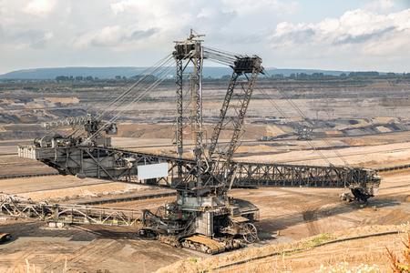 Huge bucket-wheel excavator mining lignite (brown-coal) in an open pit mine.