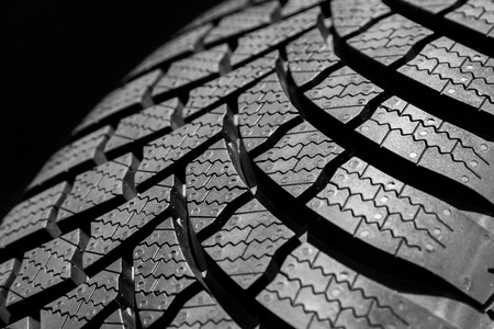grooves: car tire profile on a black background. Stock Photo