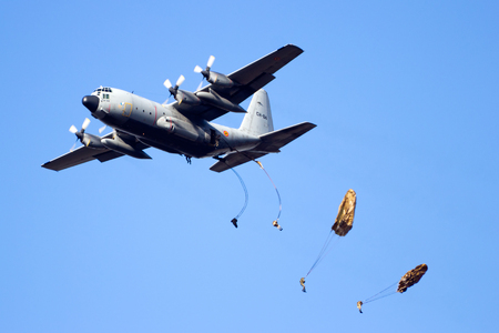 GINKELSE HEIDE, THE NETHERLANDS - SEP 22: A Belgian Air Force C-130 Hercules drops para troopers during the Operation Market Garden memorial on Sep 22, 2012 near Ede, The Netherlands. Market Garden was a large Allied military operation in September 1944 Redakční