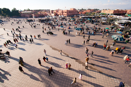 MARRAKESH, MOROCCO - JAN 27: People walking at famous Marrakesh square Djemaa el Fna on January 27, 2010 in Marrakesh, Morocco. Editorial