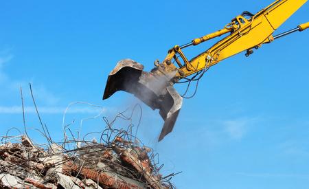dismantle: Demolition crane dismantling a building