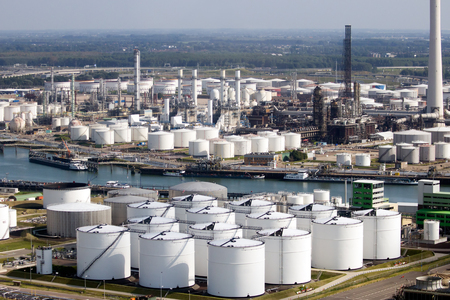 Aerial view of the port of Rotterdam with oil refinery storage tanks