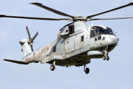 LEEUWARDEN, THE NETHERLANDS - JUN 10, 2016: British Royal Navy Merlin HM2 helicopter in flight. Editorial