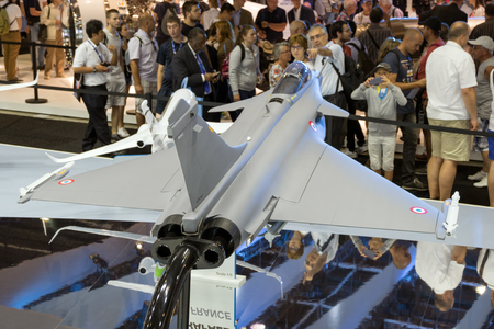 PARIS - FRANCE - JUN 23, 2017: Visitors watching the mock-up planes at a stand of the French aircraft manufacturer Dassault Aviation during the Paris Air show. Editorial