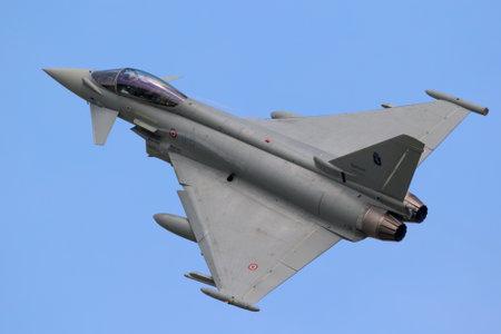 FLORENNES, BELGIUM - JUN 15, 2017: Italian Air Force Eurofighter Typhoon fighter jet aircraft in flight.