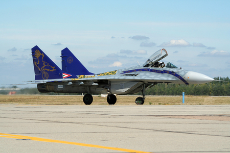 KECSKEMET, HUNGARY - AUG 17, 2008: Hungarian Air Force MiG-29 Fulcrum fighter jet taxiing to the runway. Editorial