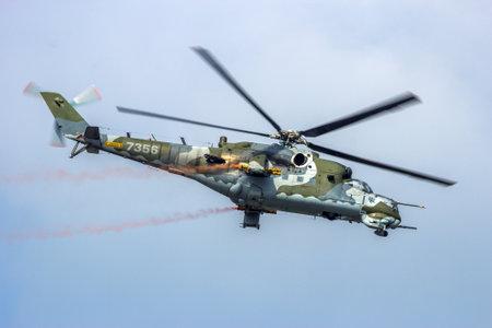 sep: KLEINE BROGEL, BELGIUM - SEP 13, 2014: Czech Air Force Mi-24 Hind attack helicopter in flight. Editorial