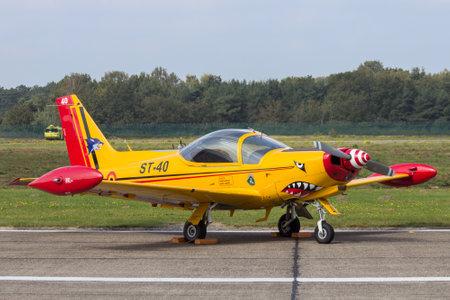 sep: KLEINE BROGEL, BELGIUM - SEP 13, 2014: Belgian Air Force SIAI-Marchetti SF.260 trainer plane on the tarmac of Kleine-Brogel airbase.