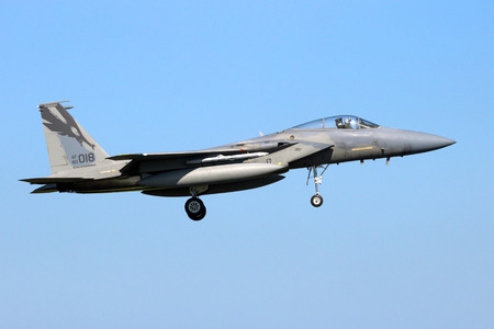LEEUWARDEN, THE NETHERLANDS - APR 21, 2016: US Air Force McDonnell Douglas F-15C Eagle fighter jet from the 144th Fighter Wing (California Air National Gurd) landing on Leeuwarden airbase during military exercise Frisian Flag. Editorial