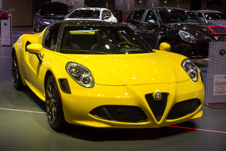BRUSSELS - JAN 12, 2016: Alfa Romeo 4C sports car on showcased at the Brussels Motor Show. 新聞圖片