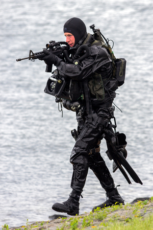 DEN HELDER, THE NETHERLANDS - JUN 23, 2013: Special Forces combat diver during an amphibious assault demo at the Dutch Navy Days.