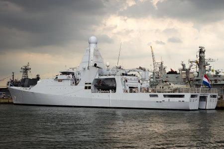 DEN HELDER, THE NETHERLANDS - JUL 7, 2012: New Dutch Navy patrol ship HRMS Holland moored during the Dutch Navy Days. Redactioneel