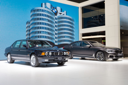 GENEVA, SWITZERLAND - MARCH 1, 2016: 1986 BMW 750iL and 2017 BMW M760Li xDrive cars showcased at the 86th Geneva International Motor Show.