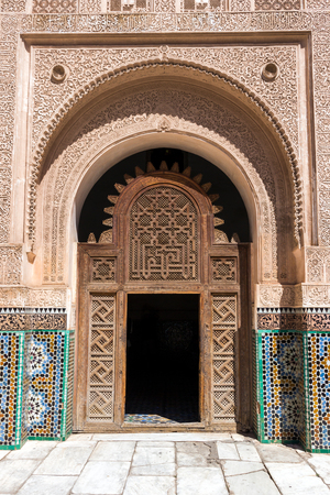 MARRAKESH, MOROCCO - APR 29, 2016: Entrance door in the inner court of the Ben Youssef Madrassa. A former Islamic college in Marrakech, Morocco.